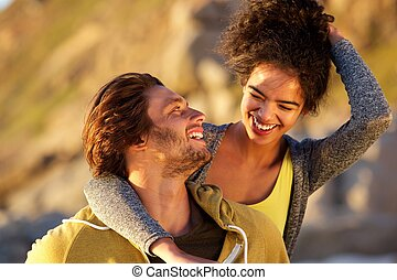 Attractive couple laughing together