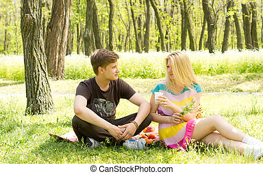 Attractive couple on a picnic date