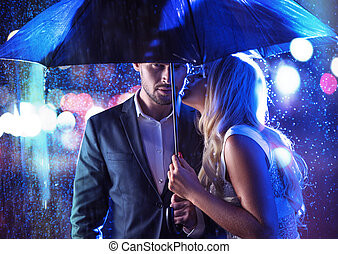 Attractive couple on a rainy date