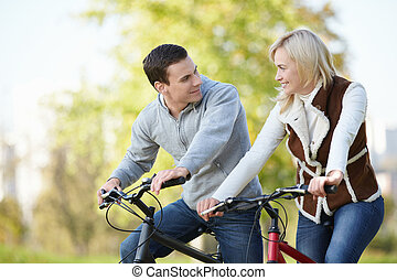 Attractive couple on bicycles