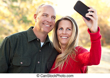 Attractive Couple Pose for a Self Portrait Outdoors