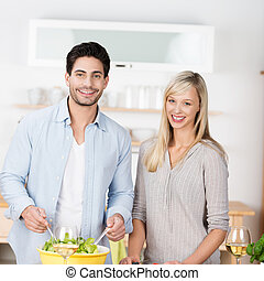 Attractive couple preparing a meal