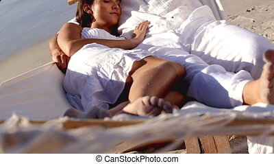 Attractive couple sleeping together