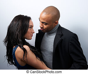 Attractive Couple Smiling At Each Other