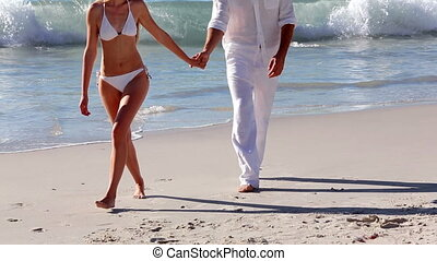 Attractive couple walking hand in h