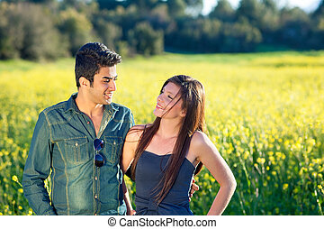 Attractive couple walking in the countryside