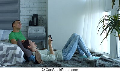 Attractive couple with tablet pc relaxing at home