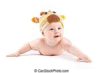 attractive cute baby boy in deer costume lies on tummy -...