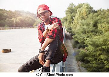 Attractive dark skinned man wearing sunglasses