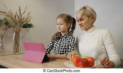 Attractive daughter is taking good looking apple from...
