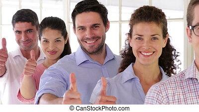 Attractive designer standing in a row - Attractive designer...