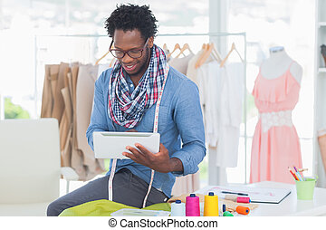 Attractive designer using tablet computer