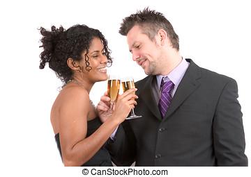 Attractive diverse couple celebrating