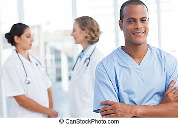 Attractive doctor with arms folded
