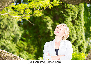 Attractive eastern europe blond smiling portrait in park