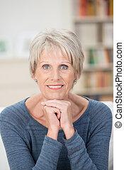 Attractive elderly blue-eyed woman
