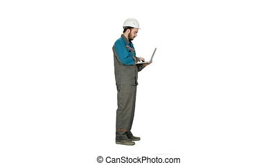 Attractive engineer using laptop on white background.