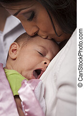 Attractive Ethnic Woman with Her Yawning Newborn Baby -...