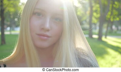 Blonde teen videos European Blonde Teen Girl With Natural Make Up Walks In Nature On A Sunny Day Fashionable Model Soft Smiles Posing Outdoors Canstock