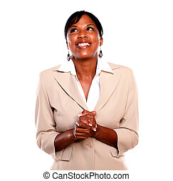 Attractive executive woman smiling and looking up against...