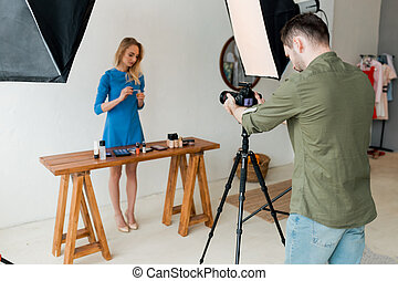 attractive fair-haired girl testing beauty products, trendy job, occupation,
