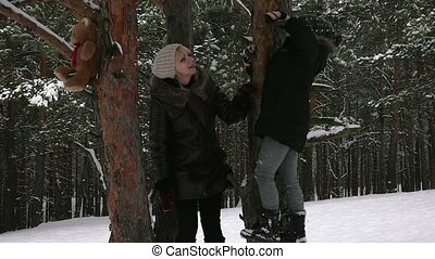 Attractive family having fun in a winter park 96fps
