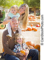Attractive Family Portrait at the Pumpkin Patch