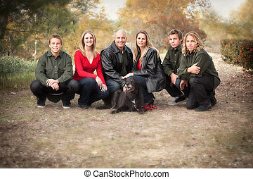 Attractive Family Pose for a Portrait Outdoors - Happy,...