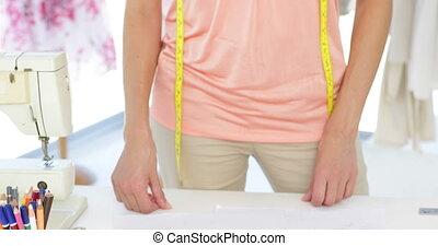 Attractive fashion designer holding