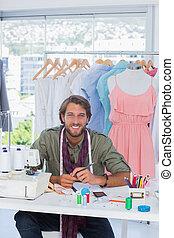 Attractive fashion designer smiling