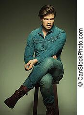 fashion man resting on a stool
