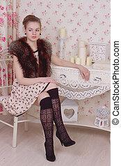 attractive fashionable woman in interior