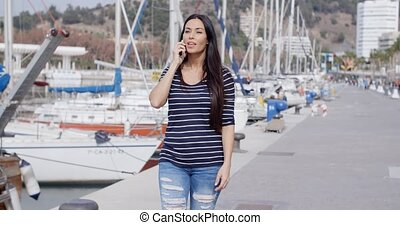 Attractive fashionable young woman on her mobile