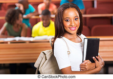 female african college student holding a book