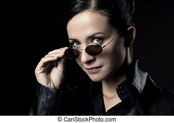 Attractive female agent in black leather coat