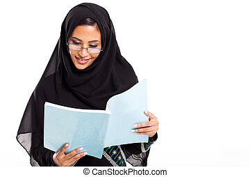 female Arabian college student reading
