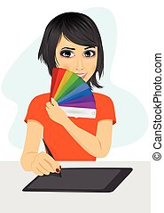 attractive female asian graphic designer showing pantone color chart palette