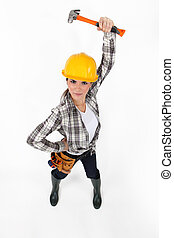 Attractive female builder holding hammer