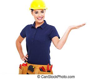 female builder presenting