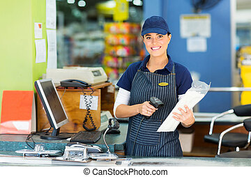 female cashier at hardware store - attractive female cashier...