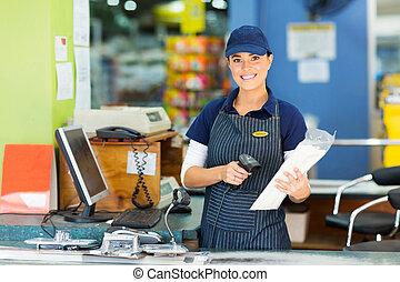 female cashier at hardware store - attractive female cashier...