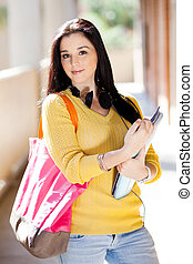 attractive female college student portrait in school