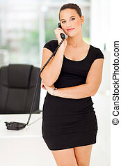 female corporate worker talking on the phone