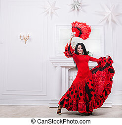 attractive female dancer in red dress performing dance