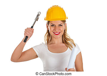 Attractive female engineer holding a hammer