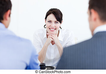Attractive female executive at a meeting