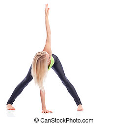 Attractive female gymnast exercising at studio