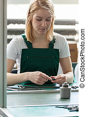 Attractive female line worker in manufacturing centre