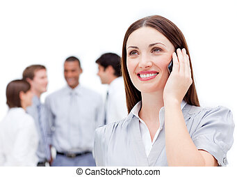 Attractive female manager using a mobile phone