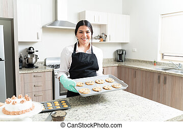 Attractive Female Pastry Chef Holding Cookies For Baking